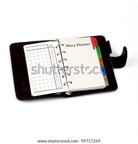"A diary opened at page of ""Diary planner"". Isolated on white background - stock photo"