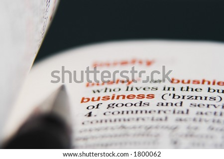 "A dictionary opened at a word ""business"" with a pen on it - stock photo"