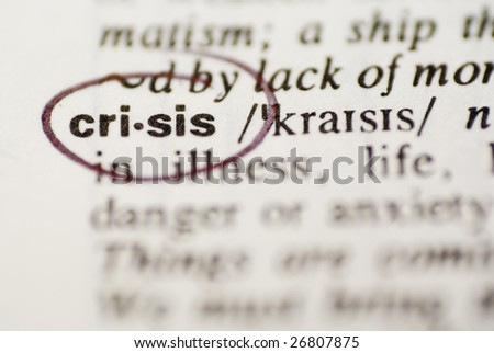 A dictionary with circled word crisis - stock photo
