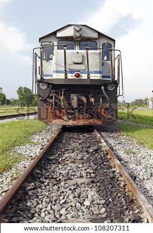 A diesel engine train head on a railway track in rural Malaysia. - stock photo