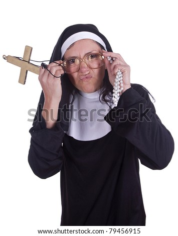 A different nun with a funny expression. - stock photo