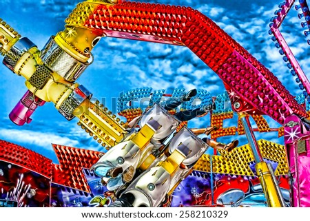 A digitally constructed painting of a colouful fairground ride - stock photo