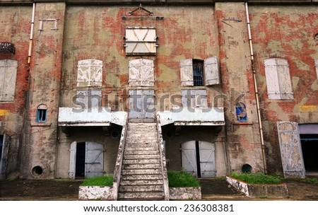 A dilapidated old factory building from the Japanese colonial period  - stock photo