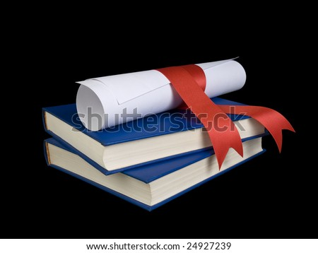 A diploma with a red ribbon over two blue books. - stock photo