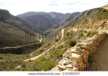 A dirt road through the Swartberg Mountain Pass - South Africa - stock photo
