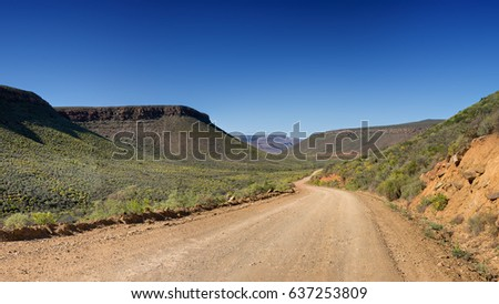 A dirt road winds through the wilderness in the Northern Cape, South Africa
