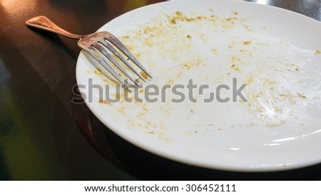 A dirty dish after finished meal - stock photo