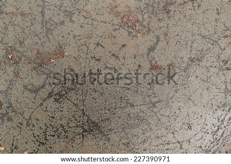 A dirty, greasy ply with scratches the surface of the pan. - stock photo