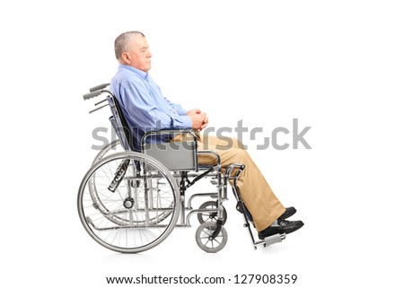 A disabled senior man posing in a wheelchair isolated on white background - stock photo