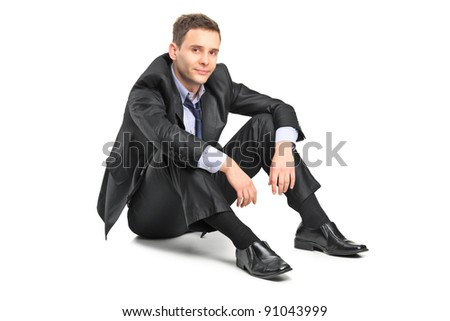 A disappointed businessman isolated against white background
