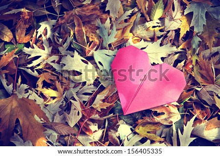 a discarded paper heart - stock photo