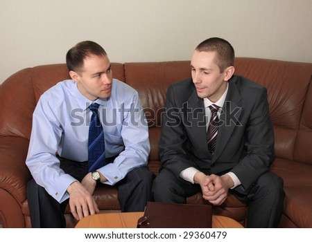 A discussion of agreement two businessmen is in an office.