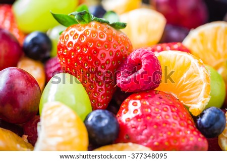 A dish full of various fresh colorful fruits