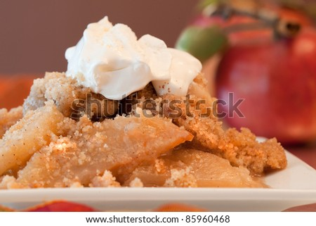 A Dish Of Apple Crisp with Whipped Cream Topping