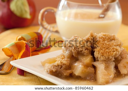 A Dish Of Apple Crisp with Whipped Cream Topping and Eggnog - stock photo