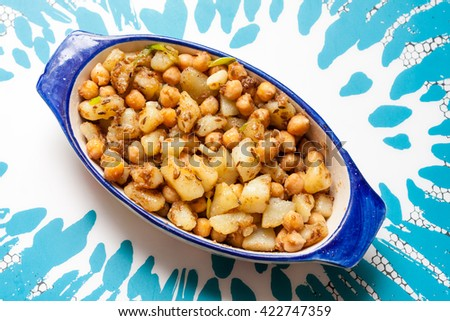 A dish of chickpea and potato curry - stock photo