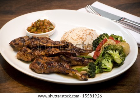 A dish of Lamb Tagine with rice and vegetables. - stock photo