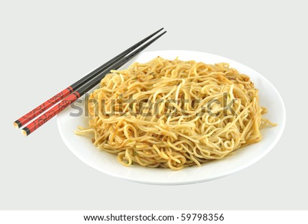 A dish of noodles and chopsticks in the gray - stock photo