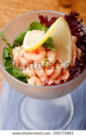 A dish of shrimp cocktail. - stock photo