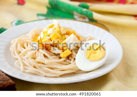 A dish of spaghetti and eggs for breakfast