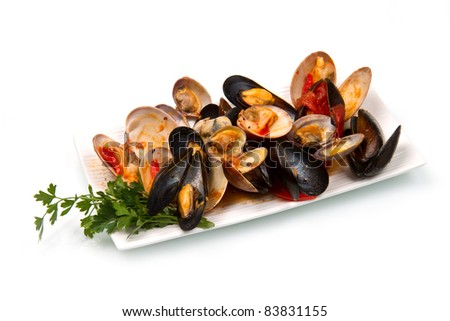 a dish  with mix of mollusk - stock photo