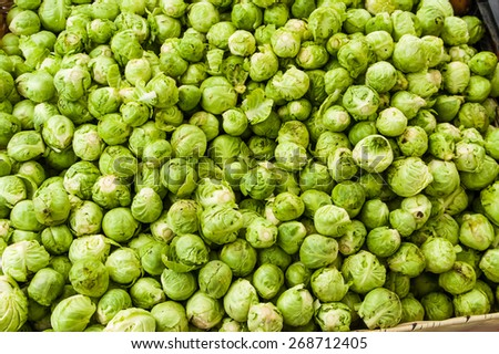 A display of brussel sprouts at the market - stock photo