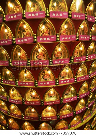 A display of Buddha at a temple. - stock photo