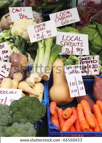 A display of fresh English vegetable produce on a market stall in Great Yarmouth, Norfolk, England - stock photo