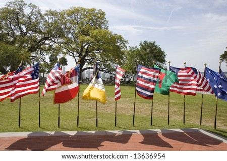 A display of historic american flags at a park