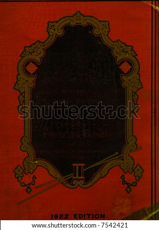 A distressed vintage book front cover with an ornate frame for the title, on faux leather.  The words of the title have been removed to allow designers to add their own title. - stock photo