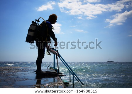 A diver prepares to dive into the water - stock photo