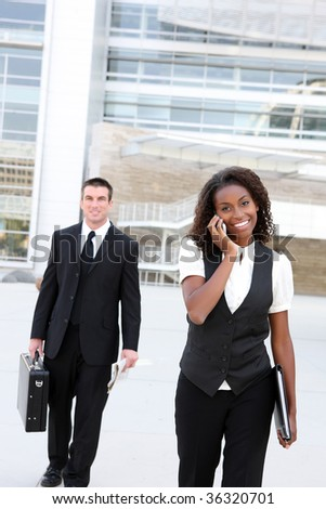 A diverse african and caucasian man and woman business team - stock photo