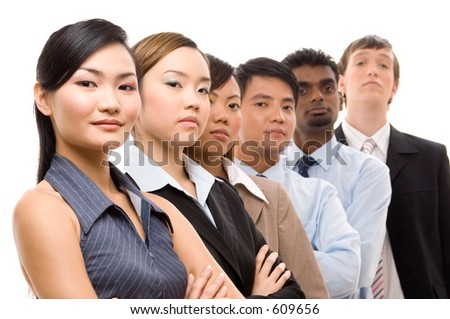 A diverse and mixed group of business people looking confident - stock photo