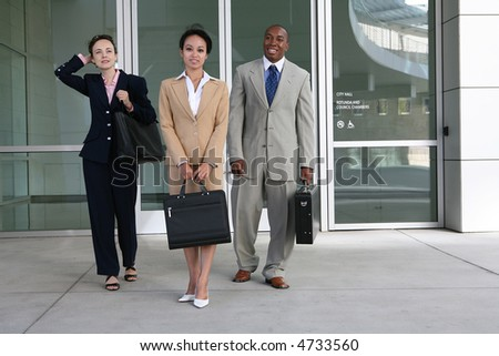 A diverse attractive business team leaving the company - stock photo