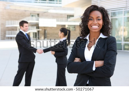 A diverse attractive man and woman business team at office building