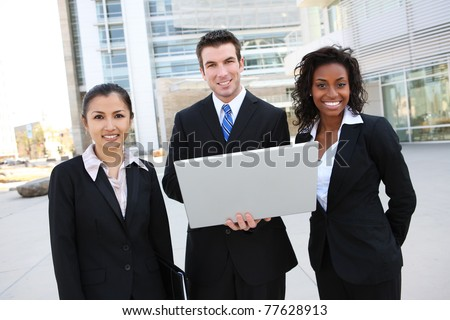 A diverse attractive man and woman business team at office building with computer - stock photo