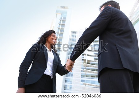 A diverse attractive woman and man business team at office building - stock photo