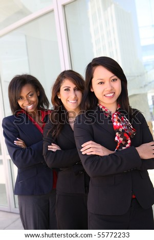 A diverse attractive woman business team at office building - stock photo