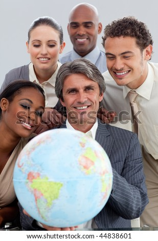 A diverse business group showing a terretrial gobe in the office - stock photo