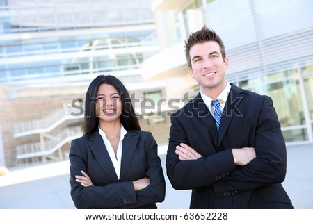 A diverse  business man and woman team at office building - stock photo