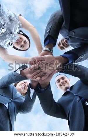 A diverse business man and woman team with hands together - stock photo