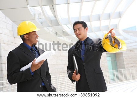 A diverse business man team working construction on the building site - stock photo