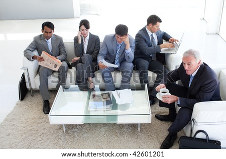 A diverse business people sitting in a waiting room. Business concept.