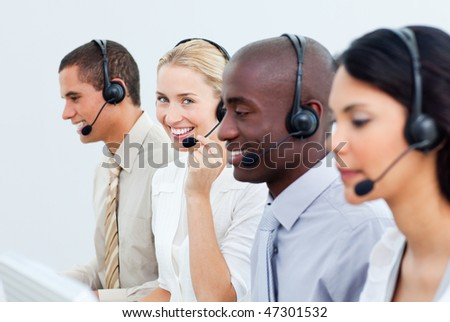 A diverse business people working in a call center in the office - stock photo