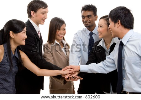 A diverse business team celebrate their success - stock photo