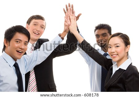 A diverse business team celebrate their success with a high five - stock photo