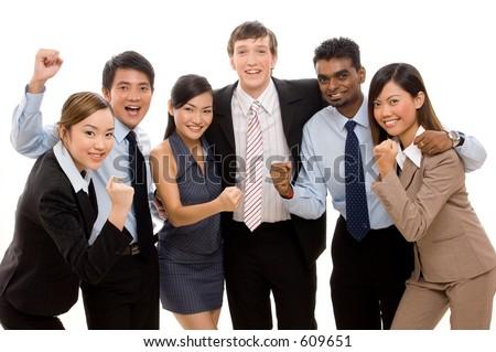 A diverse business team celebrates a success - stock photo