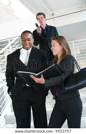 A diverse business team walking down stairs - stock photo