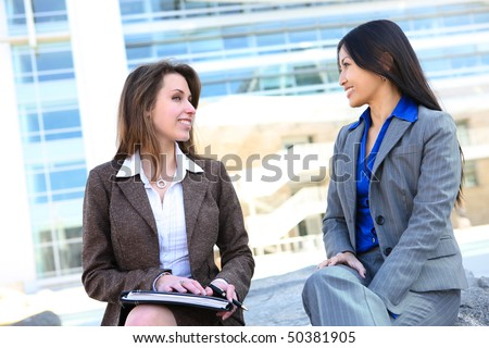 A diverse business woman team at office building - stock photo