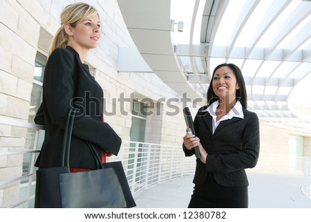 A diverse business woman team at their company